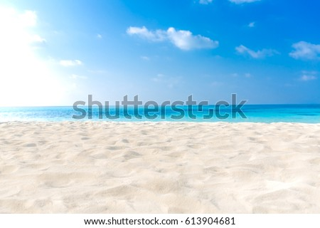Empty tropical beach background. Horizon with sky and white sand #613904681