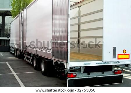 Empty truck and trailer with open back door - stock photo