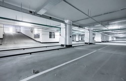 Empty underground parking lot or garage. Space for car parking - empty garage