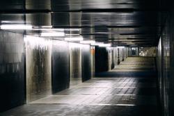 Empty Underground pedestrian tunnel. Underpass walkway.