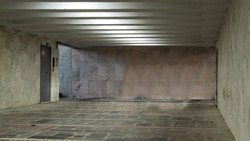 Empty underpass, shot from inside, walls and floor made of stone plates, Chisinau, Moldova