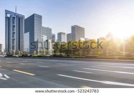 Empty urban road and buildings blurred