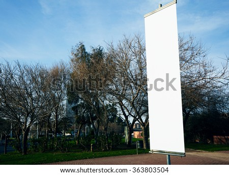 Empty vertical banner on the city square.  #363803504