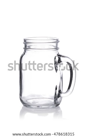 Empty vintage Mason jar with handle on white background reflection