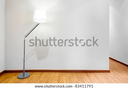 Empty wall with copy space and lamp