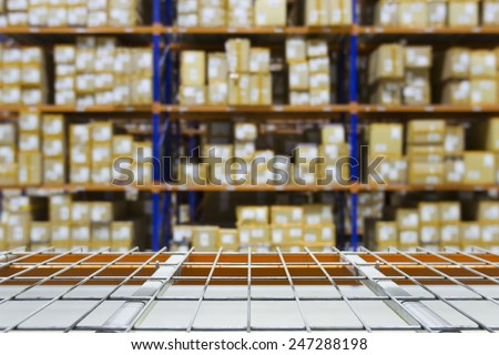 Empty warehouse shelves with defocused background on racking