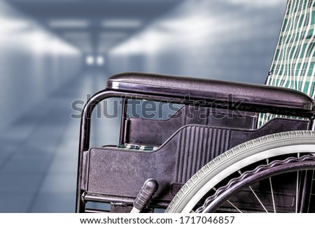 Empty wheelchair in hallway of hospital or retirement nursing care home with copy space. Concept of sickness, loneliness, neglect, isolation due to pandemics, outbreaks, epidemics, illness, lockdowns. Stock photo ©