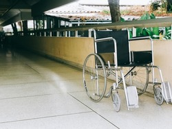 Empty wheelchair on the hallway