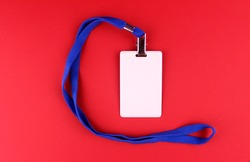 Empty white badge with blue drawstring on red background