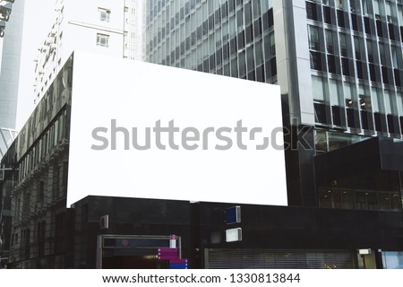Empty white billboard on city building. Public ad and commercial concept. Mock up