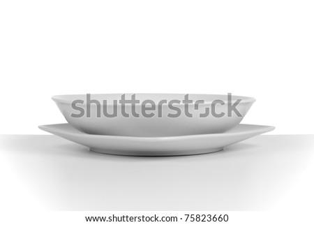 Empty white ceramic soup dish on white background.