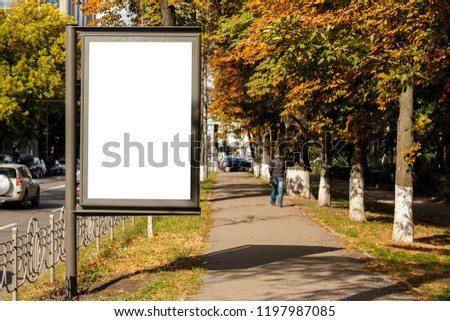 empty white citylight near the pedestrian road. blank vertical billboard on the street during autumn, Blank template