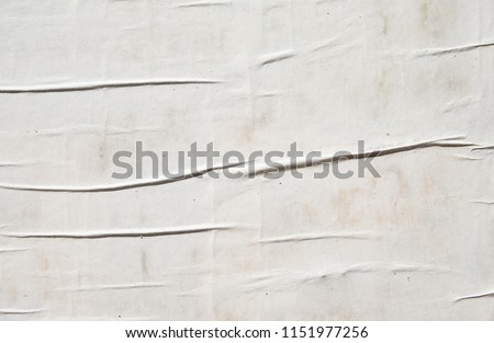 empty white creased advertising poster