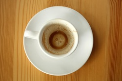 Empty white cup after espresso coffee - top view
