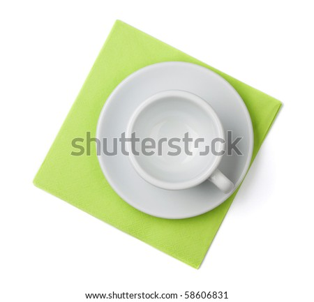 Empty white cup on green placemat. Above view. Isolated on white background