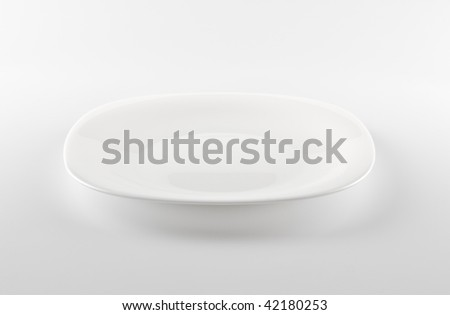 empty white dish on grey background - stock photo