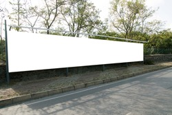 Empty white horizontal wide billboards at the roadside for mock up.