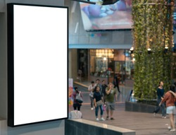 Empty white LCD display at department store walkway with blur people in background, isolated billboard frame for advertisement design