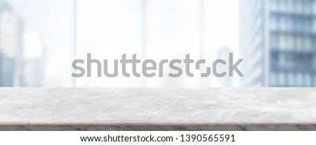 Empty white marble stone table top and blur glass window wall building banner mock up background - can used for display or montage your products.