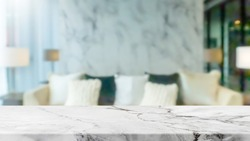 Empty white marble stone table top and blurred home interior with curtain window background. - can used for display or montage your products.