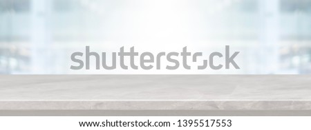 Empty white marble stone table top on blurred with bokeh shopping mall and restaurent interior banner background - can be used for display or montage your product.