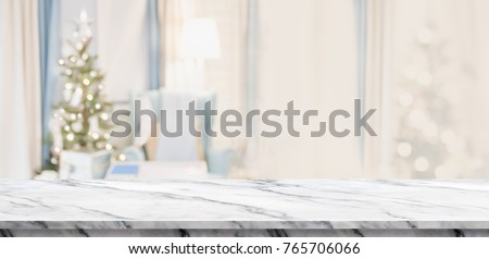 Empty white marble table top with abstract warm living room decor with christmas tree blur background with bokeh light,Holiday backdrop,Mock up banner for display of advertise product ,luxury house #765706066