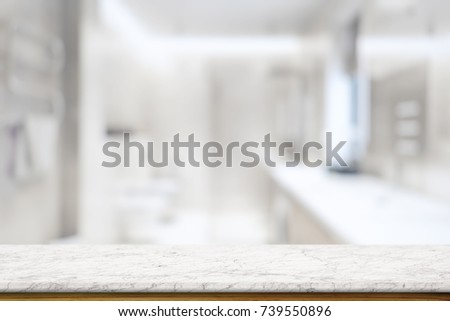 Shutterstock Empty white marble top table and blurred bath room background. for Procuct display montage.