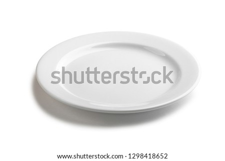 Empty white plate. Classic dishware item for serving desserts and small portions of food.