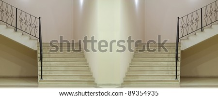 Empty white room in large hall with stairs