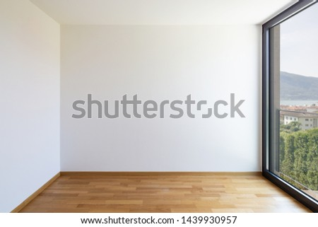 Empty white room with light parquet and window overlooking Lake Maggiore. Nobody inside #1439930957