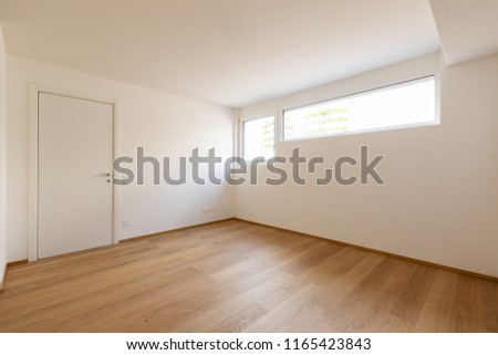 Empty white room with windows, doors and parquet, concept. Nobody inside