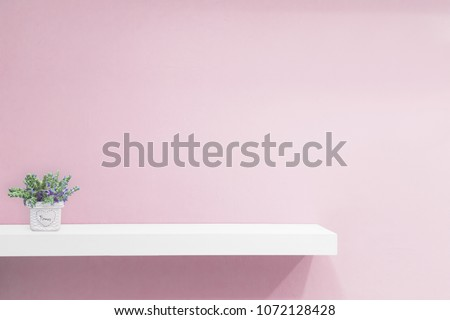 Empty white shop shelf, retail shelf on pink vintage background. - Shutterstock ID 1072128428