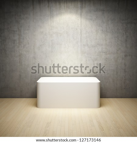 Empty white stand in interior room with concrete wall and spotlight