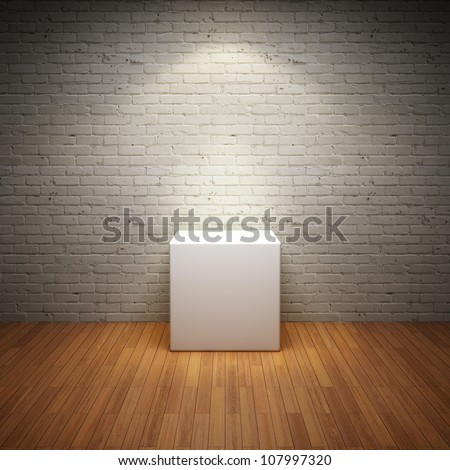 Empty white stand in old interior room with brick wall and light spot