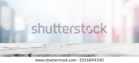 Empty White Stone table top and blur glass window wall building banner mock up background - can used for display or montage your products.