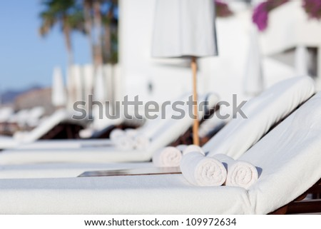 empty white sunbeds at the modern resort