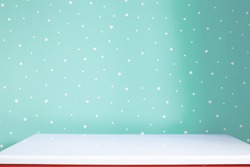 Empty white tabletop in soft turquoise kids room