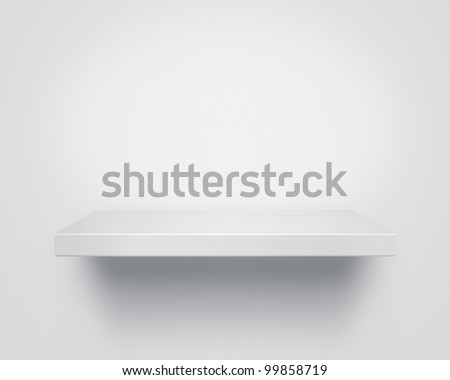 Empty white wooden shelf at the wall with copy space