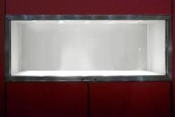 empty window display showcase glass on red wall