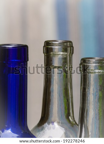 empty Wine bottle necks with backgrounds