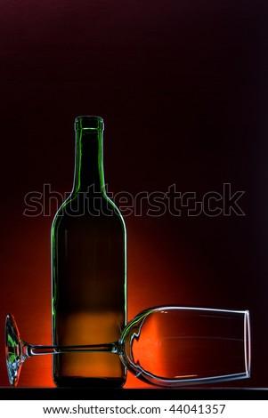 Empty wine bottle with wine glass