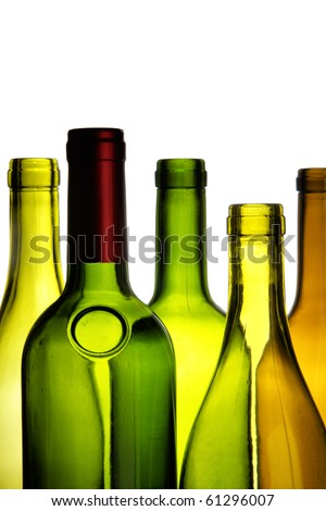 Empty wine bottles close-up isolated over white background