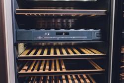 Empty Wine fridge in a kitchen home rack.