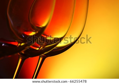 empty wine glasses in a row, with graduated coloured background