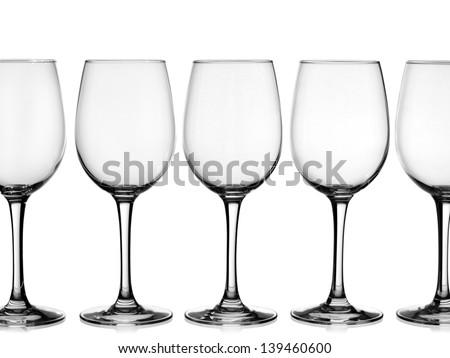 Empty wine glasses in line