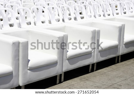 Empty with white armchairs and plastic chair outdoor event