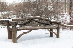 Empty Wood Bench with Snow at Central Park in New York City during the Winter