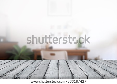 Empty wood floor in front of blurred office workplace background, for your product display montage