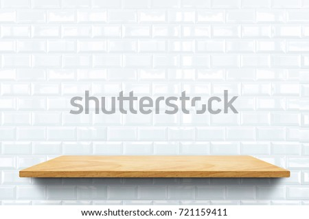 Empty wood plank shelf at white ceramic tile wall pattern background,Mock up for display or montage of product or design.