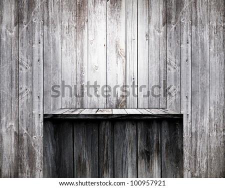Empty wood shelf on old wall